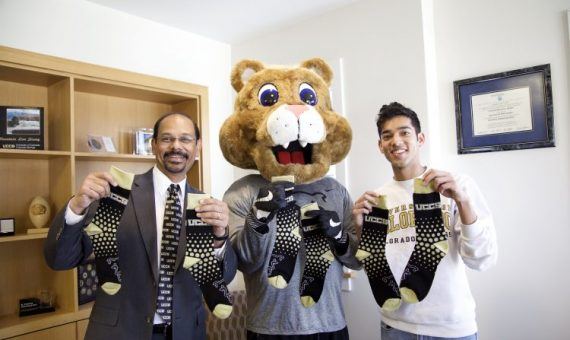 The University of Colorado Colorado Springs advancement team posing for their #RockTheSock Giving Day.
